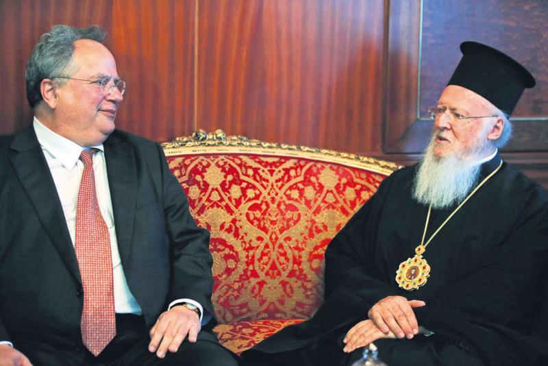 Greek FM Kotzias(L) meets Fener Greek Orthodox Patriarch Bartholomew in Istanbul on Monday.
