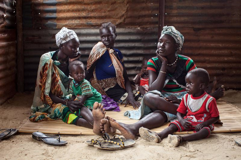 A file photo taken on July 7, 2014 shows families with malnourished children waiting to receive treatment at the Leer Hospital, South Sudan (AFP Photo)