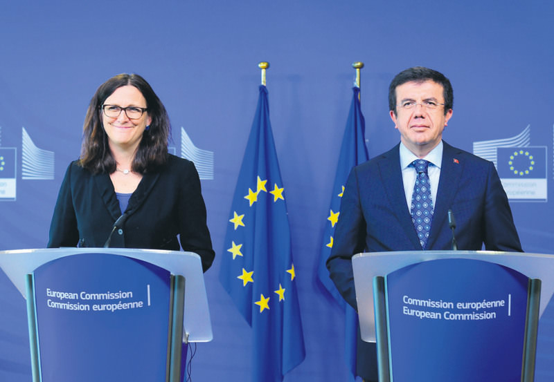 European Commissioner for Trade Malmstrom (L) and Turkey's Economy Minister Zeybekci hold a press conference after their meeting at the European Commission in Brussels.