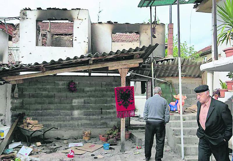 Kumanova's Albanian residents inspect their demolished homes after the police raid.