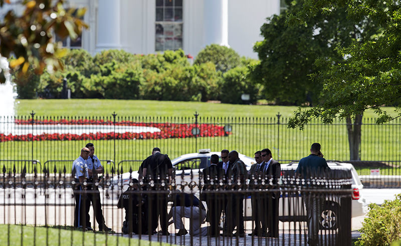 Security personnel are gathered at Lafayette Park near the White House in Washington, Thursday, May 14, 2015 during a lockdown (AP Photo)