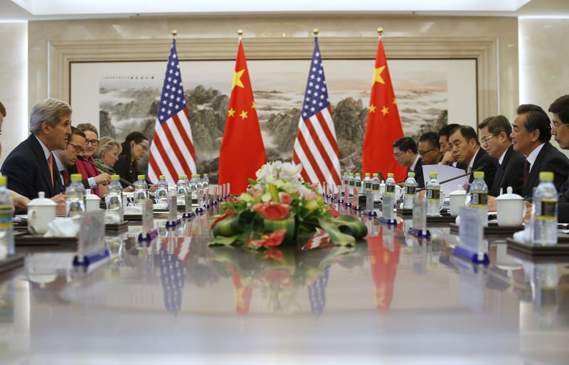 U.S. Secretary of State John Kerry, left, holds a talk with Chinese Foreign Minister Wang Yi, second right, in Beijing, China (AP Photo)