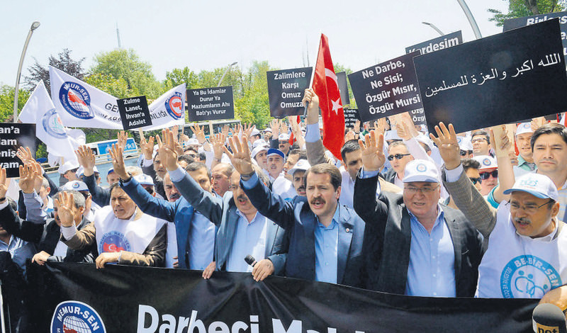 Demonstrators from Memur-Sen, a prominent labor union, made Rabaa signs at a rally condemning the death sentence for Morsi and others outside the  Egyptian Embassy in Ankara.