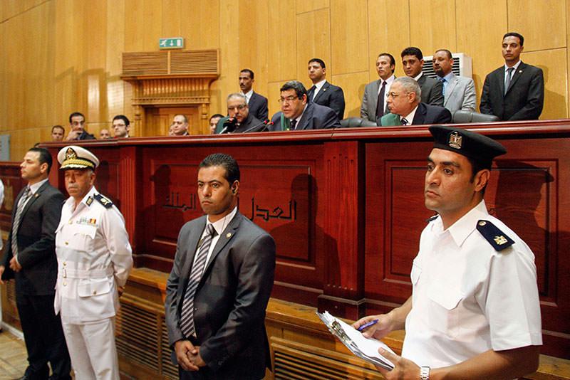 Egyptian Judge Shaaban el-Shami, center, sentences ousted Egyptian President Mohammed Morsi to death (AP Photo)