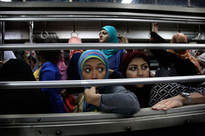 Egyptian women look from an all-female car at the Shohadaa (Martyrs) metro station in Cairo, Egypt (AP Photo)