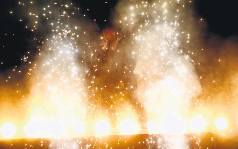 Kanye West gets booed during his smoky performance.
