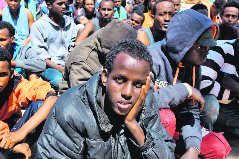 A migrant on a boat looks desperately as the European authorities are reluctant to receive them.