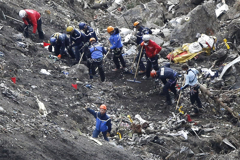 In this March 26, 2015 file photo, rescue workers work on debris of the Germanwings jet at the crash site near Seyne-les-Alpes, France (AP Photo)