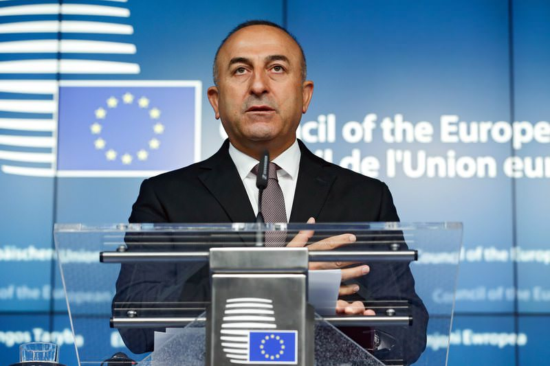 Turkish Foreign Minister Mevlut Cavusoglu attends a joint news conference after a EU-Turkey association council meeting at the European Council Headquarters in Brussels, 18 May 2015 (EPA Photo)
