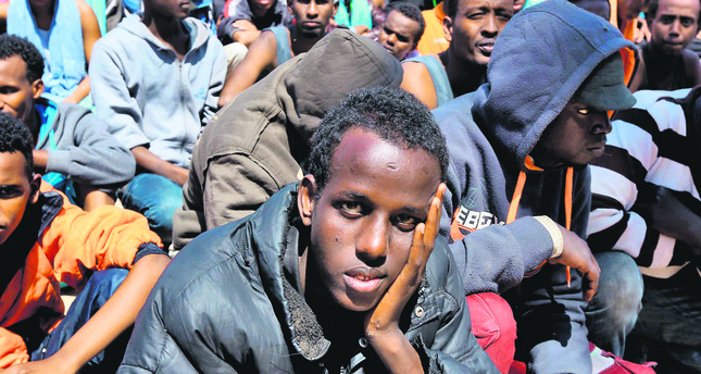 A migrant on a boat looks desperately as the European authorities are reluctant to receive them. (AFP Photo)
