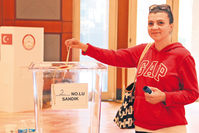 A Turkish expat casts her vote at the Turkish Embassy in Washington on Monday.