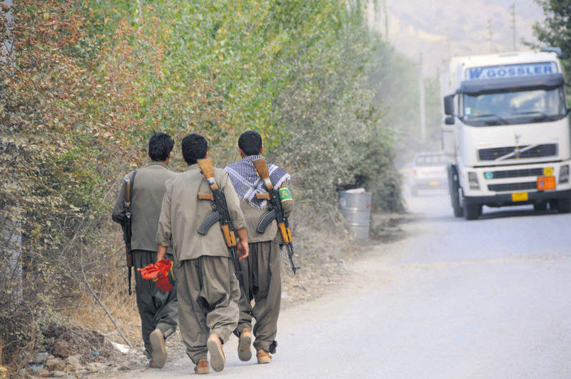 A group of PKK members are seen on a road near the border with northern Iraq.