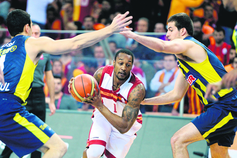 Justin Carter of Galatasaray advances among two Fener players in a March game between the two teams.