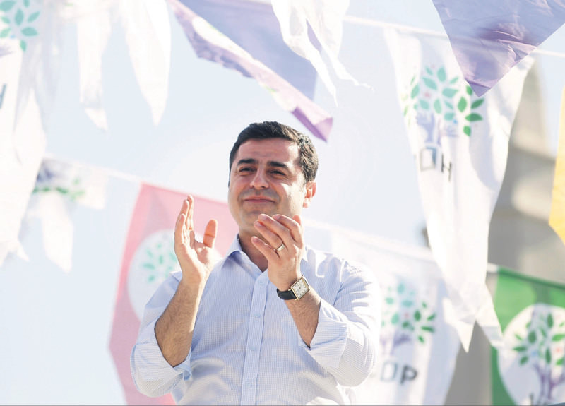Selahattin Demirtas, co-chairman of the Peoples' Democracy Party (HDP), greets his supporters during an election rally for June 7 parliamentary elections in Istanbul.