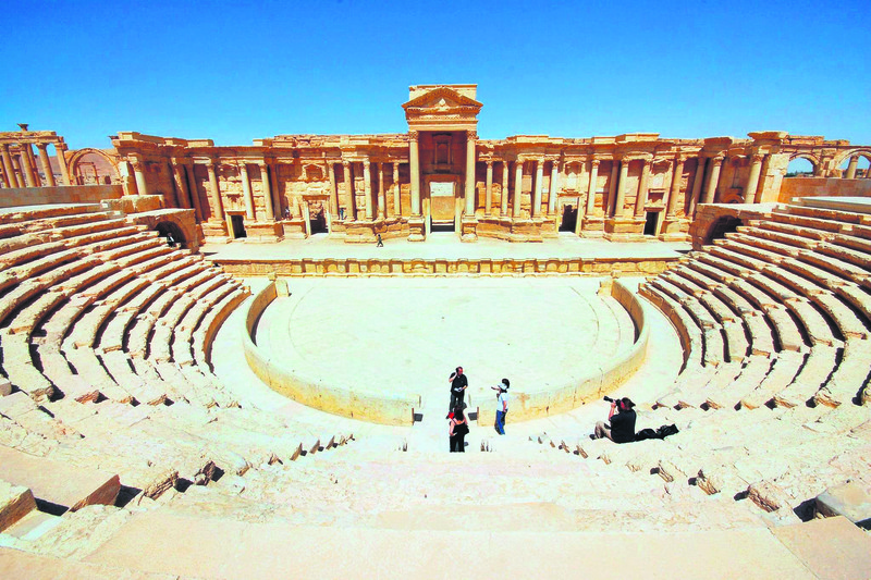 Tourists take pictures at the ancient Palmyra theater in the historical city in 2008.