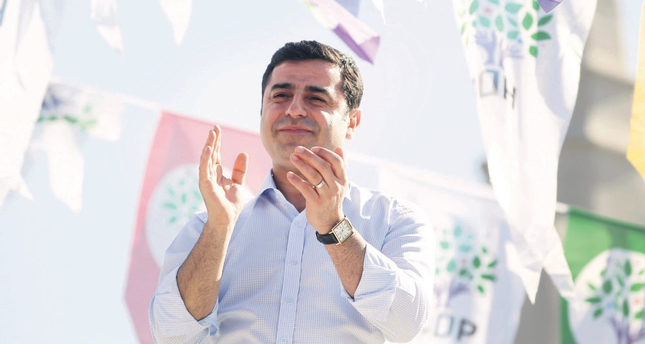 Selahattin Demirtas, co-chairman of the Peoples' Democracy Party (HDP), greets his supporters during an election rally for June 7 parliamentary elections in Istanbul. (AP Photo)