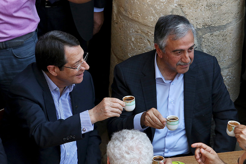 Turkish Cypriot leader Mustafa Aku0131ncu0131 (R) and Greek Cypriot leader, Nicos Anastasiades, drink coffee. The encounter was a symbolic gesture underscoring a recent thaw in relations between the two sides (Reuters)