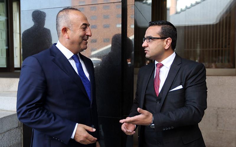 Daily Sabah Ankara Bureau Chief Ali u00dcnal (R) interviews MFA Mevlu00fct u00c7avuu015fou011flu (L) in Seoul