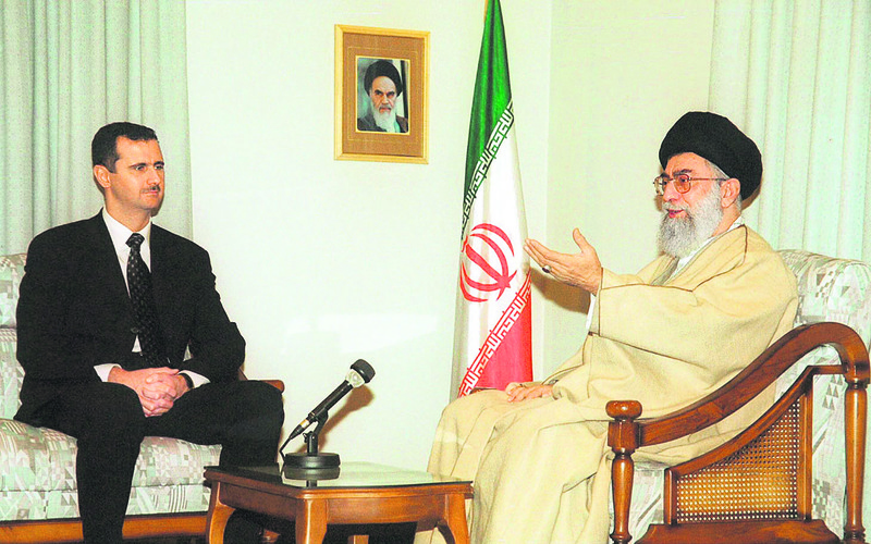 In this file photo, Iran's supreme leader Ayatollah Ali Khamenei holds a meeting with Syrian President Bashar Assad.
