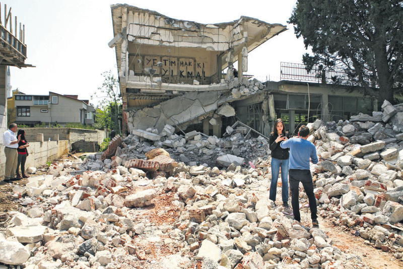 The orphanage, partially demolished, remains largely in ruins as the building was vacant for decades.