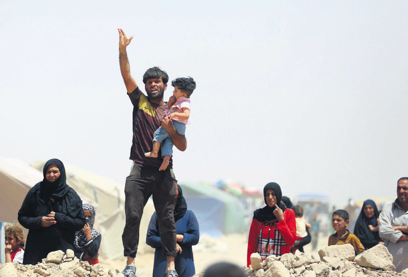 A Ramadi resident fleeing from ISIS shouts at Iraqi officials who refuse to let them leave the outskirts of the city.