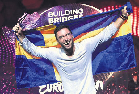 Mans Zelmerlow celebrates his victory at the Grand Final of the 60th annual Eurovision Song Contest.