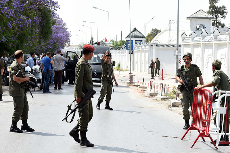 Tunisian soldiers stand guard outside the Bouchoucha army barracks in Tunis on May 25, 2015 after a soldier opened fire at his colleagues. (AP Photo)