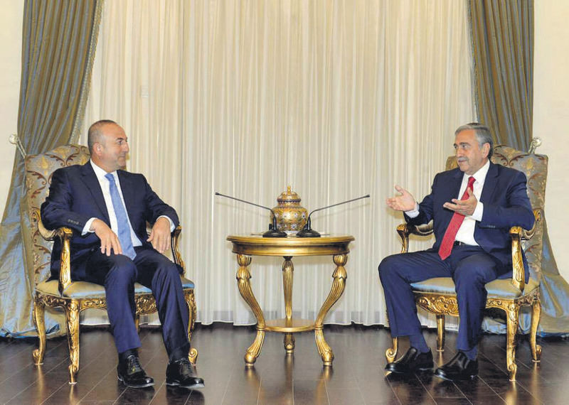 Foreign Minister Mevlu00fct u00c7avuu015fou011flu (L) meets with Turkish Cypriot President Mustafa Aku0131ncu0131 (R) in Turkish Cyprus on May 26.