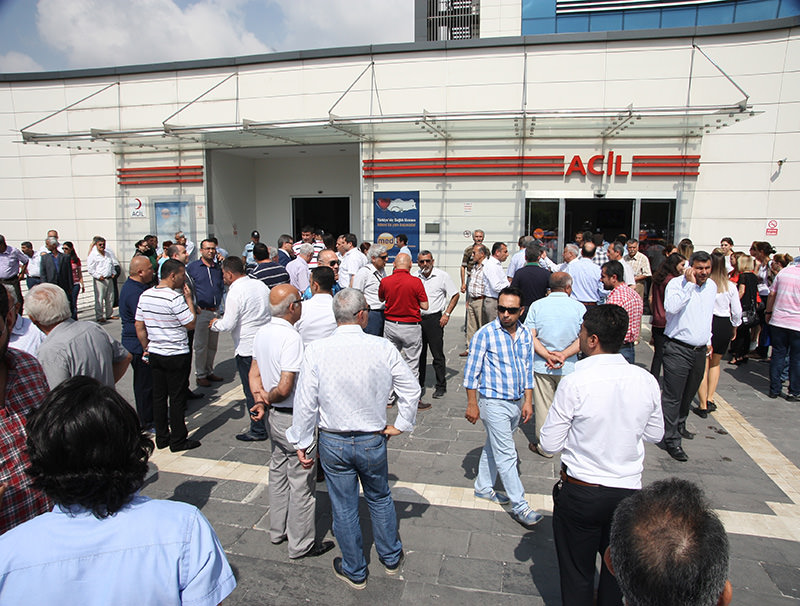 Turkey's opposition party CHP members in front of the hospital to which the wounded MP Elif Dou011fan Tu00fcrkmen was transferred to following the shooting incident on May 26, 2015 (AA Photo)