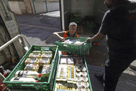 A retired train engineer, who volunteers at the Banques Alimentaires (Food Bank), transfers crates with food goods donated by a supermarket to charity organisations in l'Hay-les-Roses, France, May 26, 2015 (Reuters Photo)