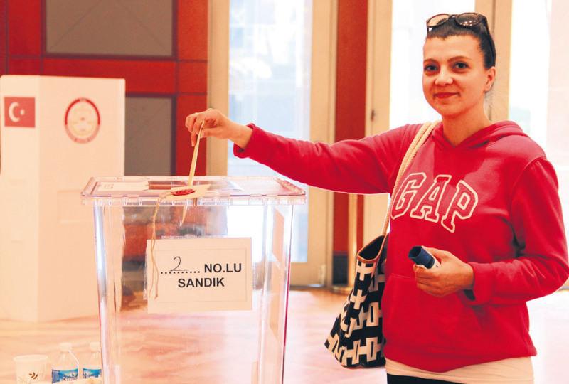 A Turkish citizen in Washington casts her vote.