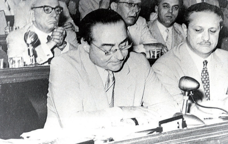 Adnan Menderes (L)reading his defense during his trial at a courtroom on Yassu0131ada island. He was hanged by the coup court in 1961.