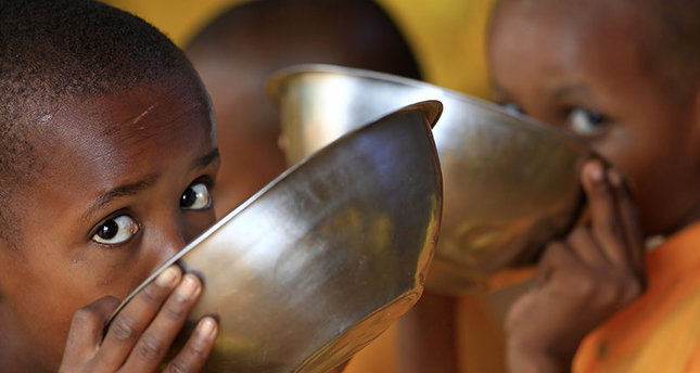 Somali refugee boys eat porridge during break time at the Liban integrated academy at the Ifo refugee camp in Dadaab, near the Kenya-Somalia border, August 2, 2011 Reuters Photo