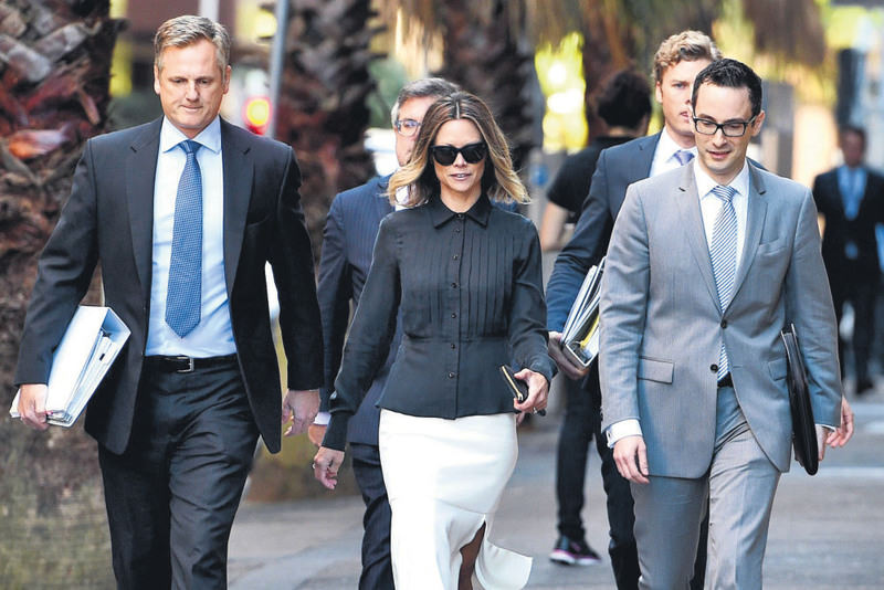 Bianca Rinehart, (center), the daughter of mining billionaire Gina Rinehart, arrives at the Federal Court in Sydney.