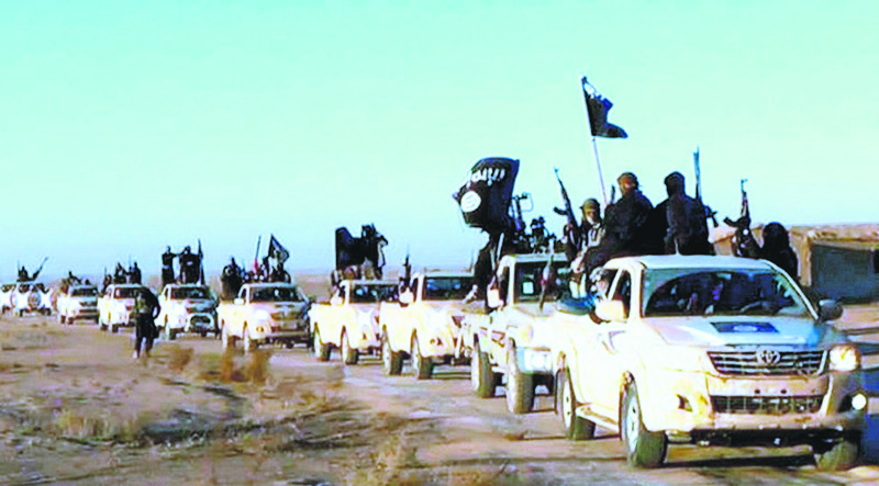 Fighters from al-Qaida's Syrian affiliate Al-Nusra Front drive armed vehicles in the northern Syrian city of Aleppo.