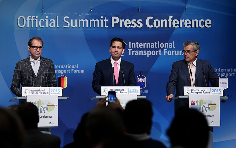 German Transport Minister, New Zealand's Minister of Energy, Resources and Transport, and Secretary General of the International Transport Forum (ITF), attend a press conference during the ITF 2015 on May 27, 2015 in Leipzig, Germany (AFP Photo)
