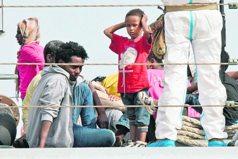 Migrants disembark from an Italian military ship as they arrive in the port of Augusta on the eastern coast of Sicily last week.