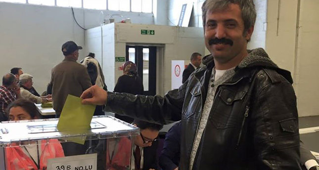 Selahattin Babir, a Turkish-origin British citizen from the UK's West Midlands, casts his vote at the polling station in London on Sunday.