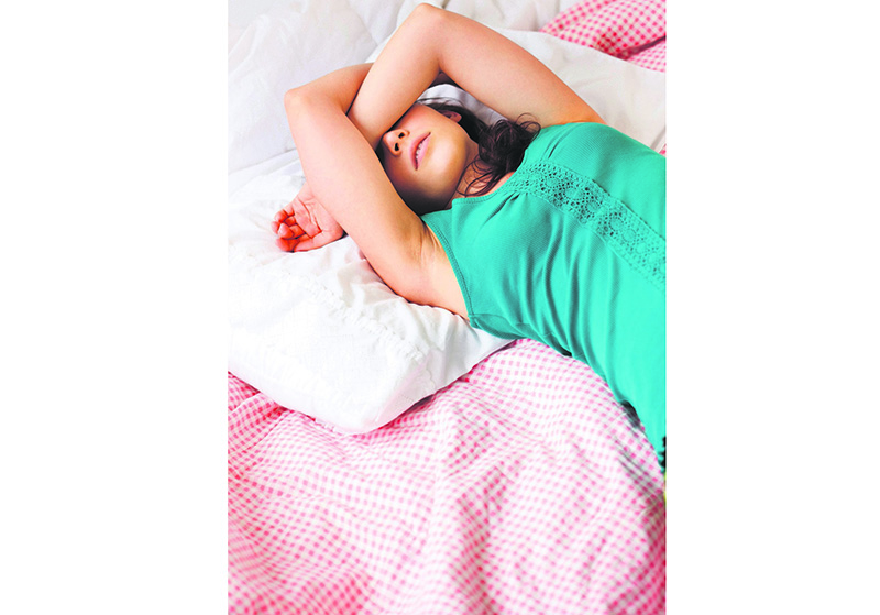 Exhausted teenage, girl sleeping on bed (Image by u00a9 Tetra Images/Corbis)