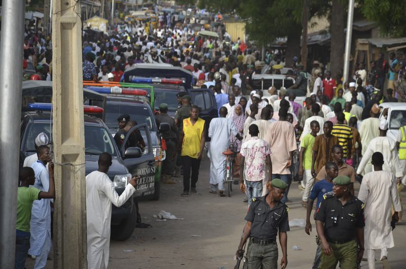 People throng the streets near the site of another explosion in Maiduguri, Nigeria, Saturday, May 30, 2015 (AP Photo)