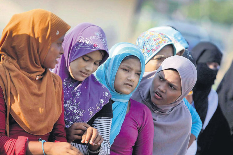 Rohingya refugee women line up for breakfast at their temporary camp in Kuala Cangkoi, North Aceh, Indonesia, June 2.
