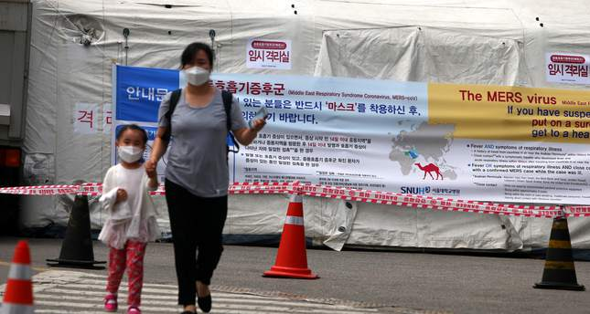 South korea reports 5 more cases of mers disease totaling 35 a mother and her daughter wearing facial mask walk near a precaution quarantine tent against the publicscrutiny Gallery