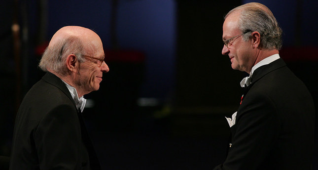 In this Friday, Dec. 10, 2004 file photo Irwin Rose of the U.S., left, receives the Nobel Prize in Chemistry from King Carl Gustaf of Sweden, right, during a ceremony at the Concert Hall in Stockholm, Sweden (AP Photo)