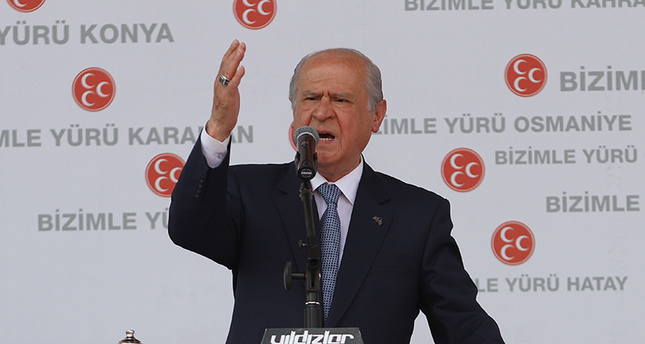 MHP chairman Devlet Bahçeli addressing a crowd at an election rally in Istanbul on Sunday. (AA Photo)