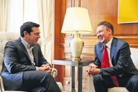 Greek PM Tsipras (L) welcomes Russian Gazprom CEO Miller at his office in Athens April 21. During talks in Moscow, Tsipras expressed interest in Greece's participation in a pipeline that would carry Russian gas to Europe through its territory.
