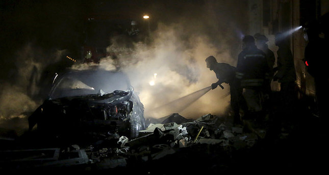 Civil defense members put out a fire at a site hit by what activists said was a barrel bomb dropped by forces loyal to Syria's President Bashar al-Assad in Maaret al-Naaman town in Idlib province June 4, 2015 (Reuters)