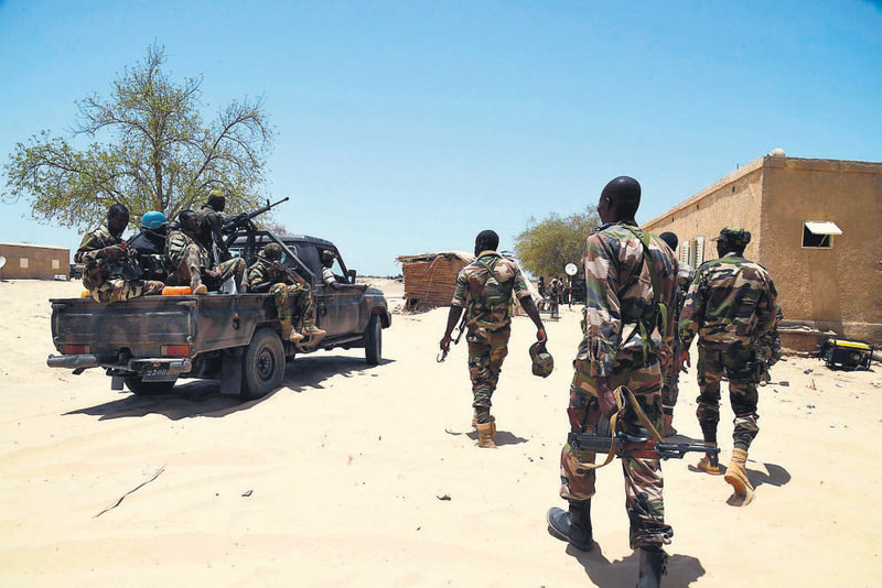 Nigerien soldiers patrol the Nigerian border near the south eastern city of Bosso.