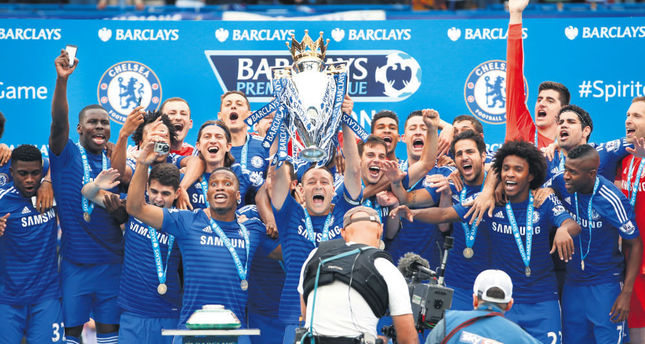 Chelsea's John Terry celebrates with the trophy and teammates after winning the Barclays Premier League. No  English clubs reached the quarter-finals of the Champions League, but they are still the envy of the continent.