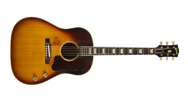 John Lennon's original 1962 J-160E Gibson Acoustic guitar is shown in this handout publicity photo released to Reuters June 2, 2015.