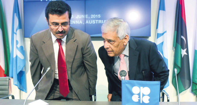 OPEC's Secretary General El-Badri of Libya (L) and Qatari Minister of Energy and Industry Al-Sada(R), who is also the OPEC Conference president
